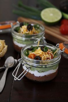 Perfect Portions: 7 layer Dip via Bellalimento    What I love is the portion size and containers; Personally I would use The Clean Eating version or @Larissa Isaac version