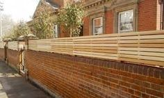 Image result for fence panel on brick wall