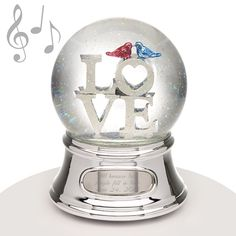 "Musical Water Globe - Love Birds - This simple water globe features the word LOVE and two small love birds and makes it the perfect gift for the special person in your life. Maybe a birthday, anniversary, wedding, or simply JUST BECAUSE; this snowglobe fits a multitude of events. This gift plays the song ""Through the Eyes of Love."" Of course, we suggest allowing us to engrave a message to let the recipient know WHO loves them and how much!"