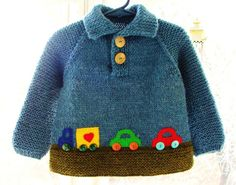 This sweater will fit little boys up to 2 years old.  Hand knitted from 100% wool, this pullover features a polo-neck collar, and bright hand appliqued felt cars with button wheels. Perfect gift for active little boys who love cars. Sturdy seamless construction.  Sweater measures 13 1/2 high, 12 1/2 across chest, and 14 from neckline to hem.  Hand wash, dry flat.