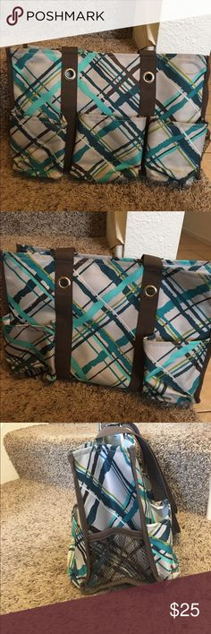 Thirty-one utility bag Thirty-one utility bag. Brown, teal, and grey. Three pockets in front, two in the back, and two mesh pockets on the sides. thirty-one Bags Totes