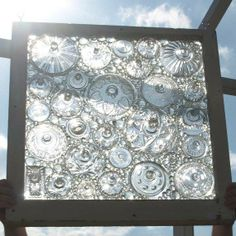 Window made with old glass lids