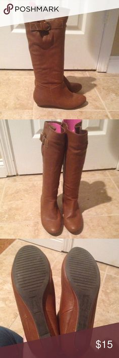 Brown Boots purchased from JCPenney Brown riding boots in great condition. One little scuff on back heel which u can see in the third picture at bottom right. Lots of wear life left. jcpenney Shoes Heeled Boots