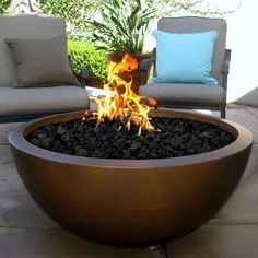 Restoration Hardwares Solution To The Outdoor Fire Pit Love It - Concrete outdoor fireplace river rock fire bowl from restoration hardware