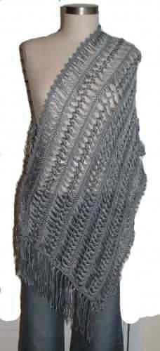 """This shawl has been created in hairpin lace using very soft and beautiful bamboo and silk blend yarn. Very elegant, unique shawl with a lovely crocheted edging and about 5 """" fringe. This shawl has a beautiful silk glow.  Size: 58x20"""" without the fr..."""