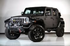 Jeep with Rhino liner coating on the exterior.