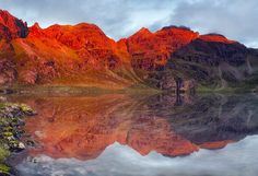 """An Teallach, Dundonnell - The name of this stunning mountain means """"the hearthstone of the forge"""" in Gaelic. It takes its name from the incredible, burning, lava-like glow of the red sandstone when the dawn sun strikes it in August."""
