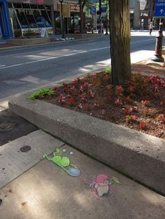 """David Zinn on his birthday 2013: """"Well, so much for the surprise birthday parade... — with Sluggo at The Himalayan Bazaar.""""   Sluggo felt down and dumped David's birthday cake on Flying Pig. Oh well, have a great birthday anyway."""
