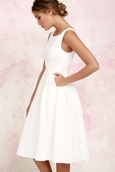 You've got high standards when it comes to your style, and the Ambitious Beauty Ivory Midi Dress will definitely rise to any occasion! Woven fabric shapes a princess-seamed bodice with a wide, rounded neckline. A full, pleated midi skirt falls from a fitted waistline, covering layers of hidden tulle. Hidden back zipper, clasp, and side seam pockets.