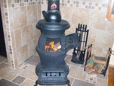 This cast iron potbelly stove is reminiscent of the potbelly stoves seen in train stations of yesteryear. This stove burns coal, warming a good&. Coal Burning Stove, Coal Stove, Cast Iron Pot, Cast Iron Stove, Tiny Wood Stove, Wood Burning Heaters, Antique Stove, Cooking Stove, She Sheds