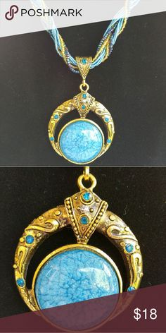 Vintage Boho Necklace Vintage Boho Necklace.  Faux turquoise large stone with smaller accent stones. The color is exquisite. Metal has antique brass look. Jewelry Necklaces