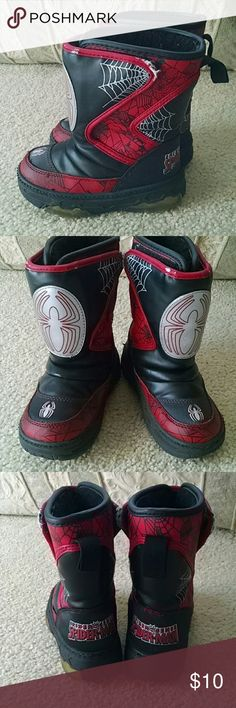 Light-up Spiderman boots Cold weather boots. Some signs of wear and tear at the edge of the red trim, but these still keep toes warm. And they still light up... Great for playing in the rain or snow. All man made materials. Buster Brown Shoes Rain & Snow Boots