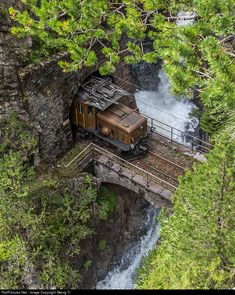 "Between the 450 m long Wiesen I tunnel and the 969 m long Bärentritt tunnel on the line from Filisur to Davos, there is a gap of only few more then 10 meter, where the passengers have a glimps of less then 1 second daylight, when the train cross the bridge of the creek, which fall down to the Zügen gorge. ""C-C"" or Rhaetian crocodil Ge 6/6 I # 415 with the ""Davos-Landwasser special"" caught in the right moment."