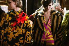 Red lilies upon a black and mustard floral design, alongside fuchsia and yellow stripes at Dries Van Noten AW14 PFW. More images at: http://www.dazeddigital.com/fashionweek/womenswear/aw14