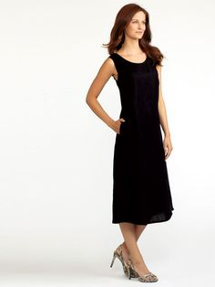 Model is wearing Black linen pocketed tank dress in  natural, slate, coffee $58 marked down