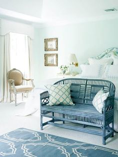 painted wicker bench at end of bed