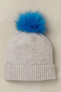 Anthropologie EU Arctic Cashmere Beanie by Helen Moore. Ah, cashmere - our most treasured of textures. We are smitten with this oh-so soft classic beanie by Helen Moore, accented with a vibrant pom pom.