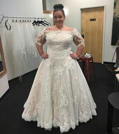This plus size wedding dress has a slight off the shoulder neck line. This cut then flows into sheer lace sleeves that end at the elbow. This plus size lace bridal gown can be easily recreated for a bride with any design change she needs or wants to make the gown her own. Our dress design firm can also produce very similar #replicas of haute couture wedding dresses for a plus size bride at a much lower cost than the original couture design.  So if your dream dress is out of your price range…