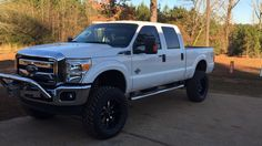 """2013 F250 6"""" Rough Country 4 link suspension lift on 20x10 Moto Metal and 37"""" Nitto"""