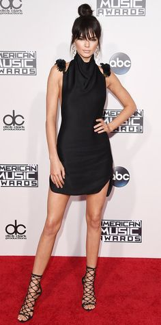 • Kendall Jenner in a black mini-dress by Oriett Domenech with Balmain heels •