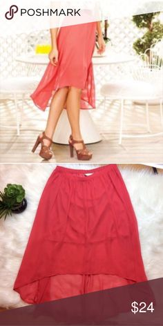 """LC Lauren Conrad Coral High Low Skirt Beautiful Lauren Conrad High- Low Skirt. Size 4. Elastic waist in back. Waist is 13 3/4"""".  Length in front is 20.5"""". Length of slip is 17"""". 100% polyester. LC Lauren Conrad Skirts High Low"""