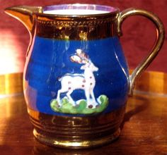 Antique : An attractive Staffordshire Victorian copper lustre pottery Jug with a blue band and sprigging