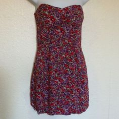 Forever 21 Sz M Multi color floral dress Shell: 100% cotton Lining:100% rayon- Beautiful Purple Red Multi Color Floral Sleeveless Dress-Underneath Purple lining-Breast Padded pads- Zipper on back- Dress is adjusted to fit mannequin. Forever 21 Dresses Strapless