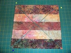 """Jenny Doan from the Missouri Quilt Company demonstrate a technique developed by """"3 Dudes Quilting"""" from Arizona,"""