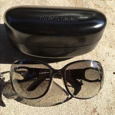 Roberto Cavalli Sunglasses Chic Roberto Cavalli black sunglasses with crystal logo and gun metal frame. Small scratch on the upper left corner of lens; out of eyesight. Small unnoticeable spot on the center connecting frame. Roberto Cavalli Accessories Sunglasses