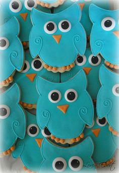 Owl decorated sugar cookies. Royal icing. Blue, orange, yellow, white, black.