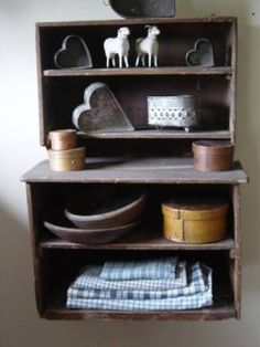 Old Wooden Shelves...putz sheep, old tin heart molds, pantry boxes & bowls.