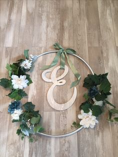 Giant wreath for front of the house made with a hoola hoop
