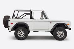 What We Did Contracted to build the perfect Floridian beach truck we came up with Amelia Island. Range Rover paint, Gullwing interior and just the right amount of power. You can't go wrong with the