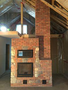 "Masonry heater w/bake oven. 22"" firebox. Brick and square cut fieldstone."