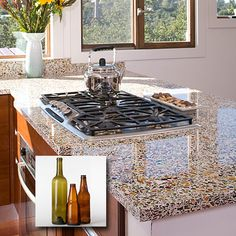 Repurposed :: Shimmery countertops :: All of the glass used in Vetrazzo countertops is recycled. Some glass comes from the bottles you toss in your recycling bin, and the rest is post-industrial glass, or leftovers from factories that make glass products. The glass is diverted from landfills to Tate, Ga., where it is mixed with cement; 85% of the slab is glass