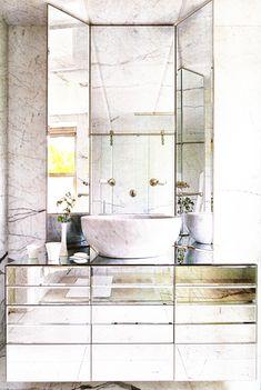 Glam bath w/ all Carrara marble and mirrored materials; Jorge Varela, AD Spain
