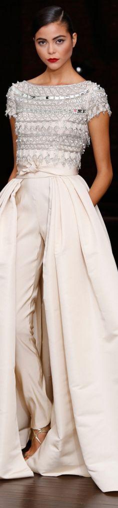 Naeem Khan Resort 2014 -love the split skirt over slim trousers retro entertaining look!-
