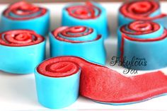 Jello Marshmellow Roll-Ups     Ingredients:  1 small package strawberry jello  1 small package berry blue jello  1 cup water  4 cups miniature marshmallows