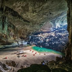 Camping inside the world's third largest cave in Phong Nha-Kẻ Bàng National Park, Vietnam.