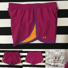 Under Armour women's athletic shorts szS    Under Armour women's athletic shorts szS    good used condition, dark pink with purple and orange detail, light grey liner, elastic drawstring waistband, small pocket on inner waistband  See other Under Armour and athletic listings in my closet Under Armour Shorts