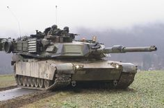 A U.S. Army Abrams M1A1 tank takes a defensive position at a staging area during Ready Crucible in Germany, on Feb. 11, 2005. Over 50 tanks from the 1st Armor Division, Humvees, and support vehicles drove through more than 60 kilometers of German roadway and farmlands making Ready Crucible the largest movement of American armor in Germany since the 1980s.  DoD photo by Richard Bumgardner, U.S. Army. (Released)