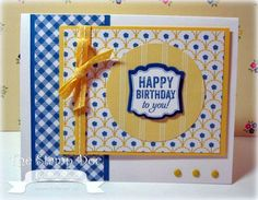 handmade birthday card ... luv the patterned papers and the design that shows them off ... blue, yellow and white ... everything matching from Stampin' Up! colors ... papers, ribbon, brads, ink ...  great card!!