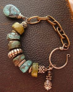 bracelet by pmdesigns09 on Etsy.  It is made of turquoise, brass, and sterling silver.
