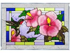 Hibiscus flowers are rendered in vibrant color and magnificent detail.