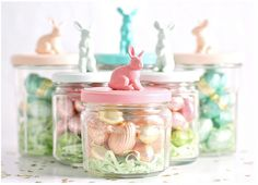 Toys and lids of jars painted in pastels and filled with candies.  Inspiration from: 56 Inspirational Craft Ideas For Easter