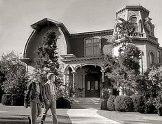 Did you know the same team behind Leave it to Beaver also wrote The Munsters? Check out Beaver and Gilbert walking past the Munsters house!