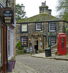 """The Black Bull pub in Haworth village, West Yorkshire. Known for its association with the Brontë sisters, the village name is thought to mean """"hedged enclosure"""". Oxford England, England Uk, London England, Cool Places To Visit, Places To Travel, Places To Go, Villages In Uk, Big Ben, Yorkshire England"""
