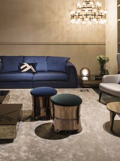 e3bfef89e5e Glamorous living room with the shades of Blue and gold by Fendi Casa. In  the scene Pagoda sofa
