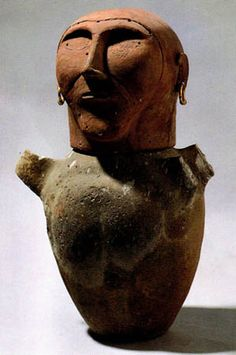 """Human-headed Cinerary Urn; c. 675-650 B.C.; Terracotta; Height 251/2"""" (64.7 cm); The remains of the deceased were placed in an urn which was put inside a pit, along with important items such as weapons, jewelry, & household tools."""