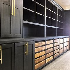 """""""Decided to paint the cabinets in our design office black and stain the materials drawers for a unique contrast. About to fill up this space with fresh…"""""""